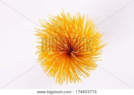 uncooked pasta beautiful view from above on a white background