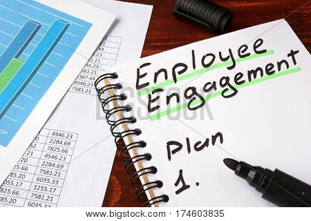 Employee engagement written in a notebook and marker.