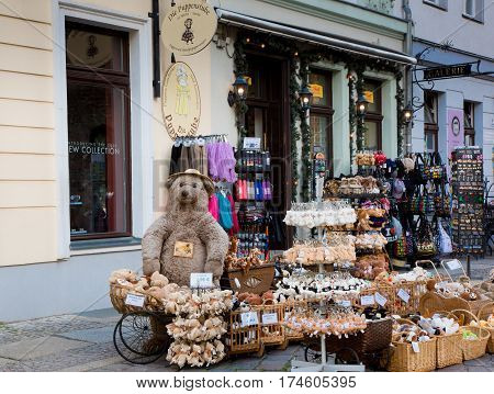 BERLIN GERMANY - JUNE 2016. Street souvenir shop in the historic quarter Nikolaiviertel Nikolaikirche in Berlin. Big Teddy bear surrounded by little toy bears