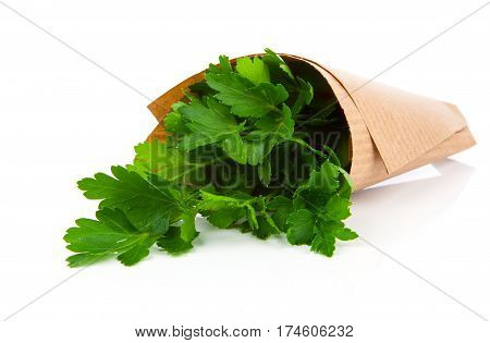 bundle of parsley in a paper package on a white background
