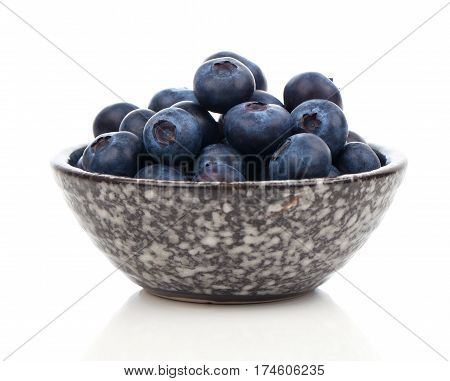 ripe blueberries in bowl on white background