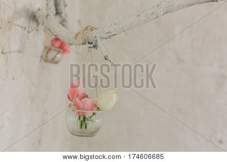 Elegant Hanging Wedding Flowers with Vibrant Colors in Perfect Lighting Original wedding floral decoration in the form of mini-vases
