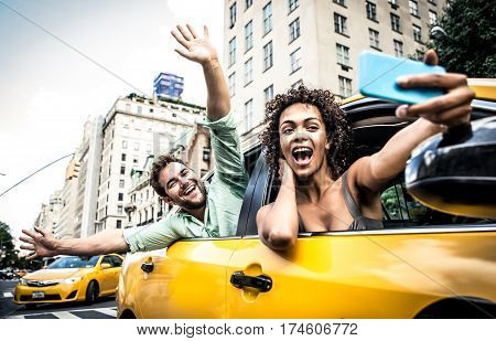 Happy couple on a yellow cab in New york