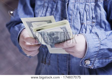 I want higher wages. Money is the best motivation. A child holding dollars banknotes. (Development business success freedom career power concept)