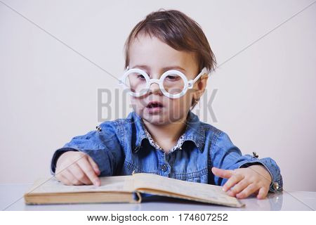 beautiful little child girl learns to read (success education childhood development)