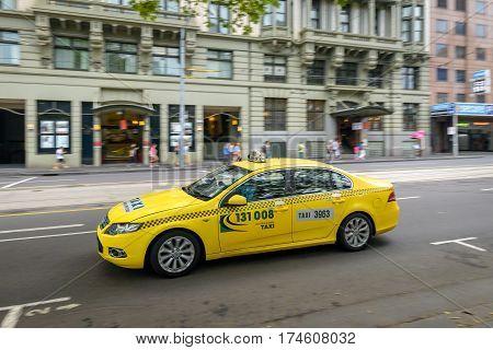 Melbourne Australia - December 27 2016: 131 008 Australia wide taxi car driving along Flinders street in Melbourne CBD