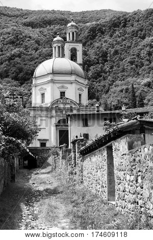 The historic church of Santa Croce at Riva San Vitale (Ticino Switzerland) along the Lake of Lugano (Ceresio) built in 16th century. Black and white