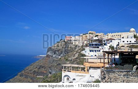 Thira, Greece - November 11, 2010: Houses in the town of Thira, the capital of the island of Santorini in Greece.