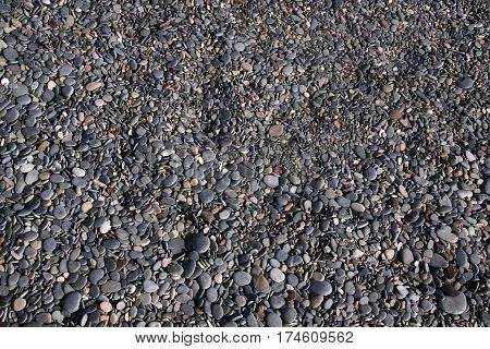Black pebbles on the beach in Antibes. Cote d'Azur France