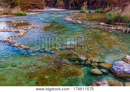 Fall Foliage On The Crystal Clear Frio River In Texas.
