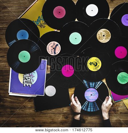 Hands with Vinyl Record Player Music