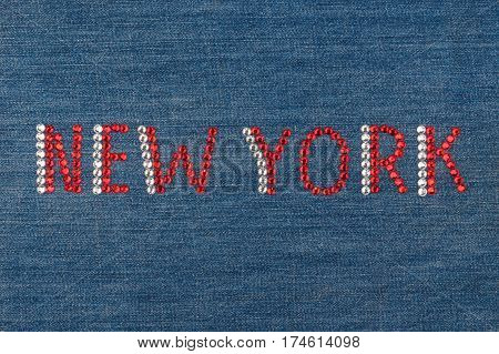 Inscription New York inlaid rhinestones on denim. View from above