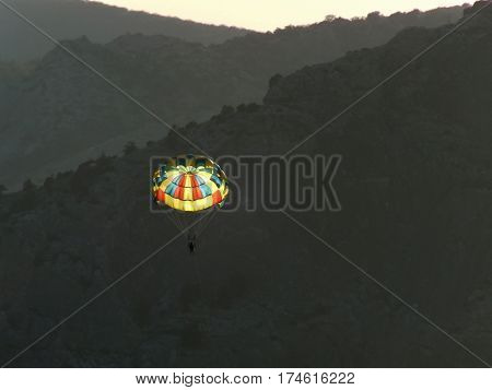 Flying parachutist on the background of the Crimean mountains