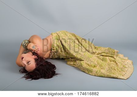 Beautiful girl belly dance movement Young beautiful belly dancer in a golden costume