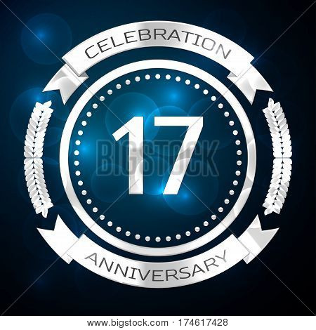 Seventeen years anniversary celebration with silver ring and ribbon on blue background. Vector illustration