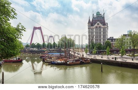 Rotterdam Netherlands - May 26 2016: the White House with the distinctive tower at the Old Port of Rotterdam with on the background the red Willemsbrug
