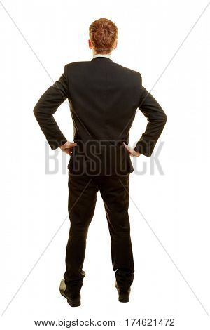 Businessman in a suit from the back with arms akimbo