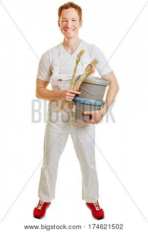 Man dressed as a painter with paint buckets and brushes on a white background