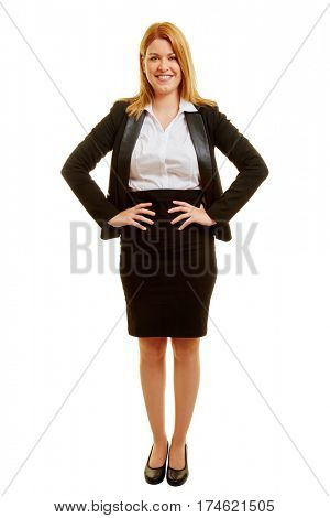 Blond smiling businesswoman with arms akimbo