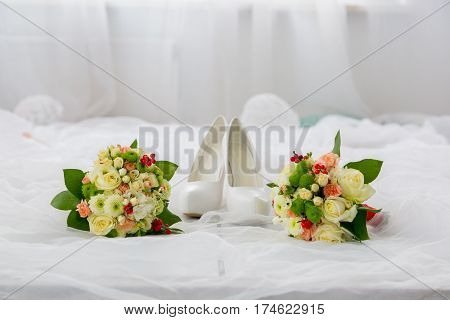 Wedding accessories: shoes boutonniere and bride's bouquet