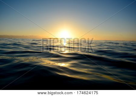 A beautiful sunrise over an undulating ocean