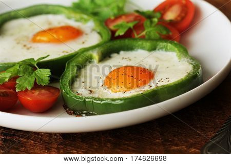 Eggs Fried in Bell Pepper Ring on wooden table