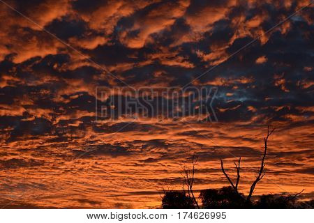 Brilliant fiery orange sunset in the clouds
