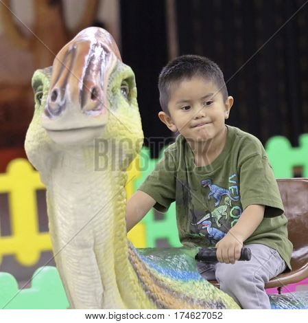 TUCSON, ARIZONA, FEBRUARY 20. The Tucson Expo Center on February 20, 2017, in Tucson, Arizona. A Kiddie Dinosaur Ride at T-Rex Planet at the Tucson Expo Center in Tucson, Arizona.