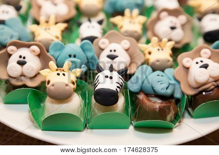 Closeup view of animal shaped little candies for birthday party