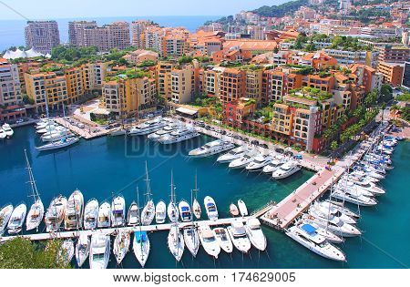 Panoramic view of Fontvieille - new district of Monaco. Boats and a high-rise apartment complex. Principality of Monaco is a sovereign city state, located on the French Riviera in Western Europe.