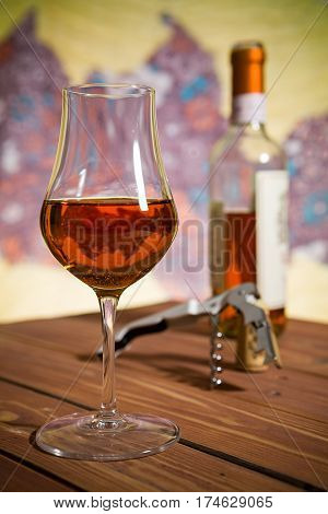 Closeup of a glass of Italian vin santo wine on a wooden table