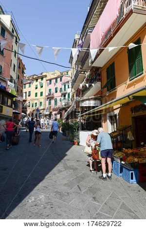 Riomaggiore Italy - 7 July 2015: people walking and shopping on the main street of the village of Riomaggiore on Italy