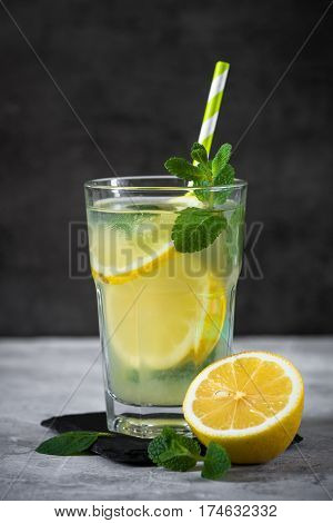 Refreshment drink lemonade. Traditional Summer drink with lemon mint and ice.