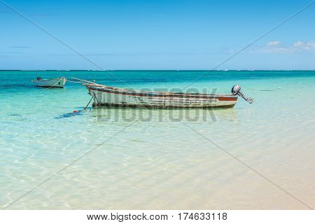 Fishing boats on the seascape and blue sky at beach