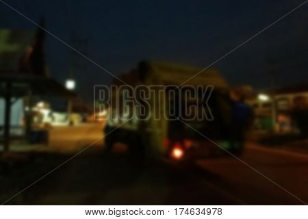 blurred photo Blurry image Officials in the garbage every day at dawn background