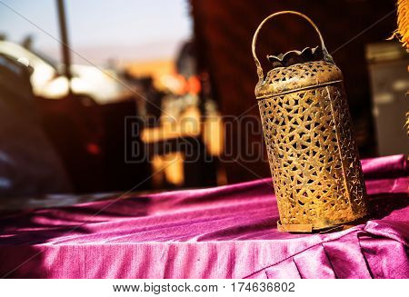 Wrought Iron Berber Lamp With Traditional Nomad Tents On Background