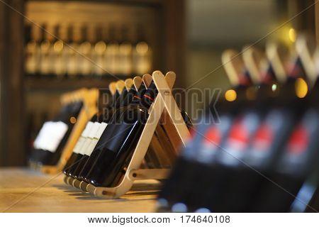 Wine bottles on a wooden shelf. Wine bar.