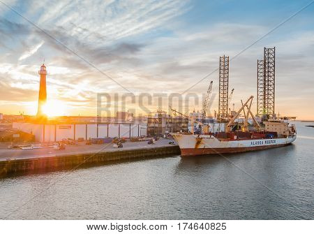 IJMUIDEN - NETHERLANDS - 20 JAN. 2017: View on the sea port of IJmuiden, Netherlands, as the sun sets. IJmuiden port is located at the entrance to the North Sea Canal area