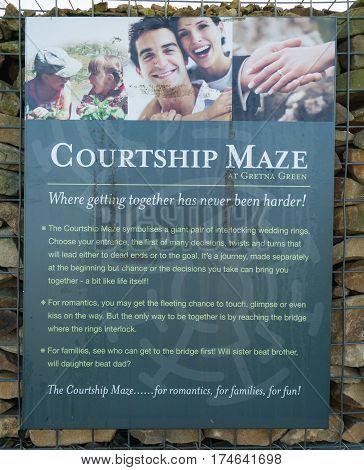 GRETNA GREEN, SCOTLAND - 21 JAN. 2017: Information panel for the courtship maze at Gretna Green, Scotland, the town were eloped couples get married