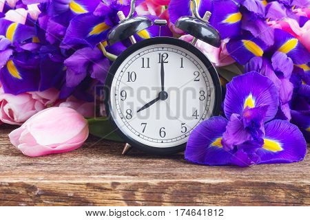 Spring time concept - retro alarm clock with flowers
