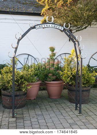 Wedding arch at the Gretna Green blacksmith, the place in Scotland where eloped couples get married over the blacksmith anvil
