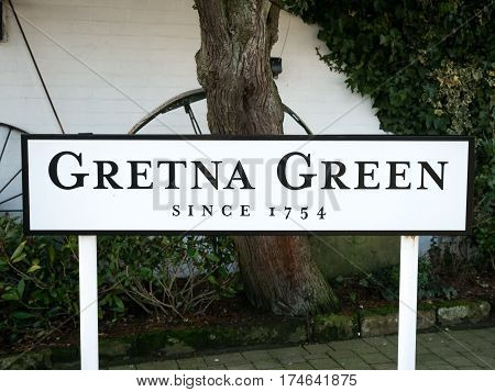 Place name sign at the Gretna Green blacksmith, the place in Scotland where eloped couples get married over the blacksmith anvil
