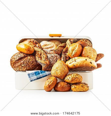 Vintage bread box with various bread rolls and buns isolated on white background clipping path included