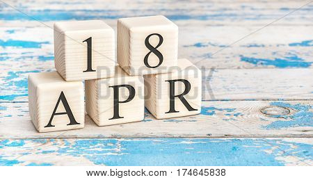 April 18Th. Wooden Cubes With Date Of 18 April  On Old Blue Wooden Background.