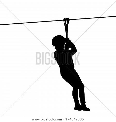 Black silhouette of a kid playing with a tyrolean traverse