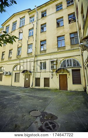 The old crumbling old houses where people live Russian St. Petersburg Disrepair. Old buildings and abandoned lots that