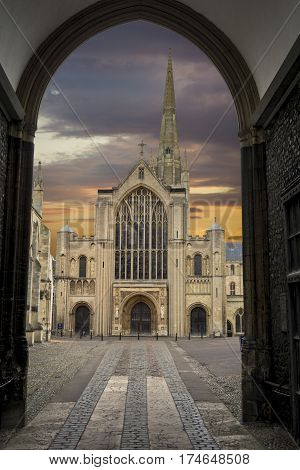 Norwich cathedral at dusk framed by doorway at main entrance
