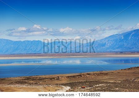 Beautiful view of Antelope Island with clouds reflecting in surface of Great Salt Lake