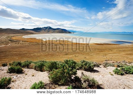 Beautiful view of salty causeway to Antelope Island on Great Salt Lake, Utah, America