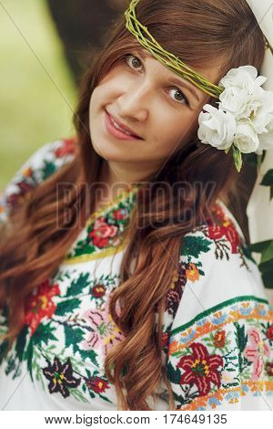 Gorgeous Brunette Woman With White Roses Wreath In Traditional Embroidered Dress Face Closeup